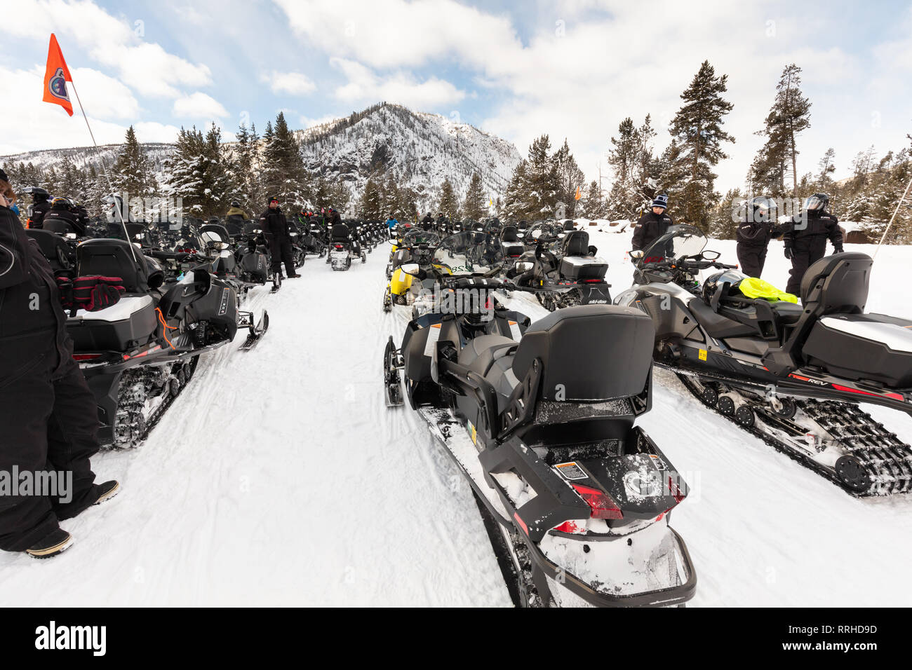 Snowmobiles park at the Madison Warming Hut February 19, 2019 in Yellowstone National Park, Wyoming. - Stock Image