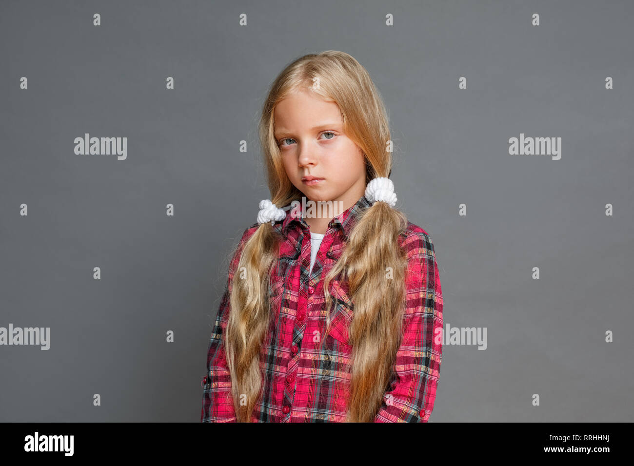 Swell Little Girl With Ponytails Standing Isolated On Grey Indifferent Schematic Wiring Diagrams Phreekkolirunnerswayorg