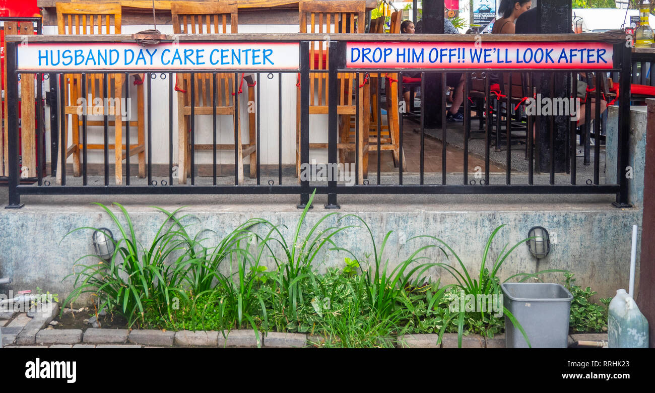 Humourous sign outside a bar in Kuta Bali Indonesia. - Stock Image