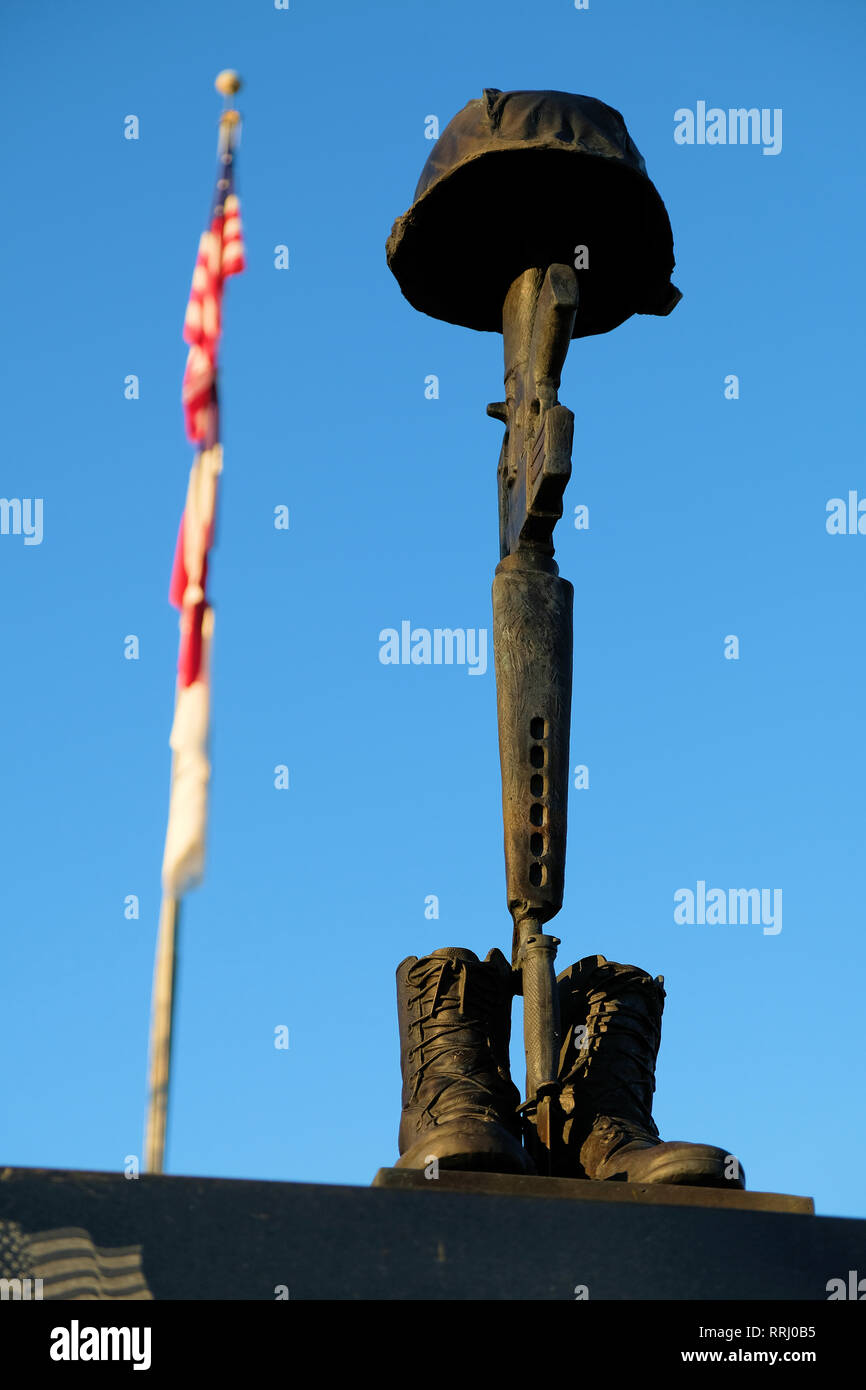 Battlefield Cross sculpture atop the Brazos Valley Vietnam Memorial located in front of the Clara B. Mounce Public Library in Bryan, Texas, USA. Stock Photo