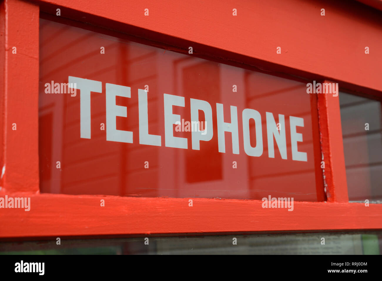 Signage on a red telephone box at Founders Museum in Nelson, New Zealand - Stock Image