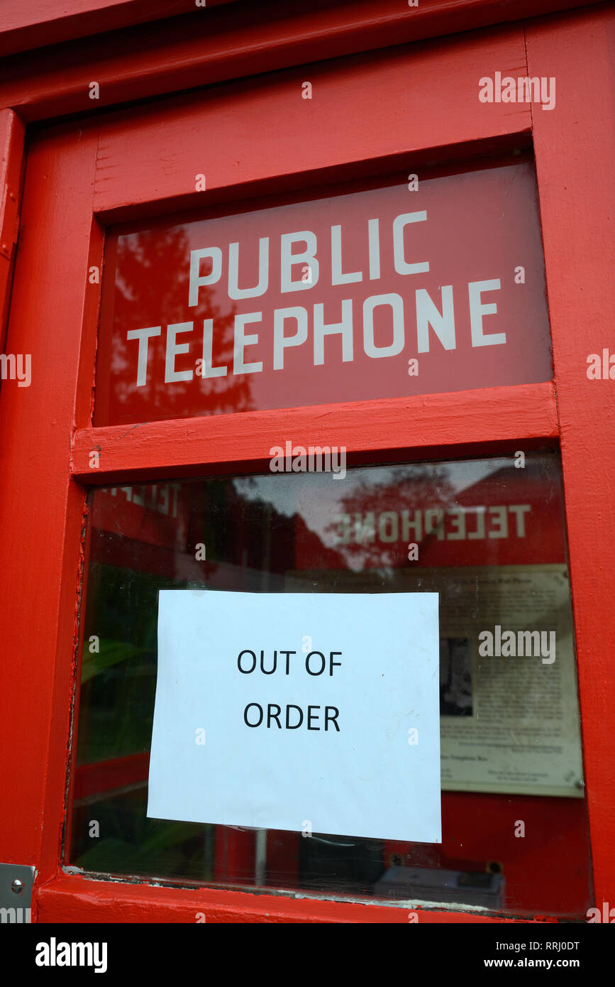 an out of order sign on a public telephone box - Stock Image