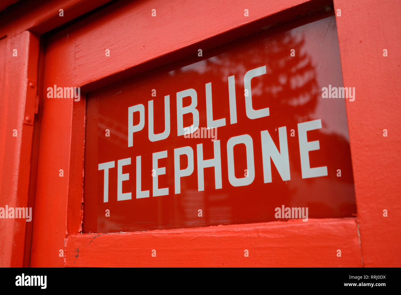 signage for a retro telephone box at Founders Museum, Nelson, New Zealand - Stock Image