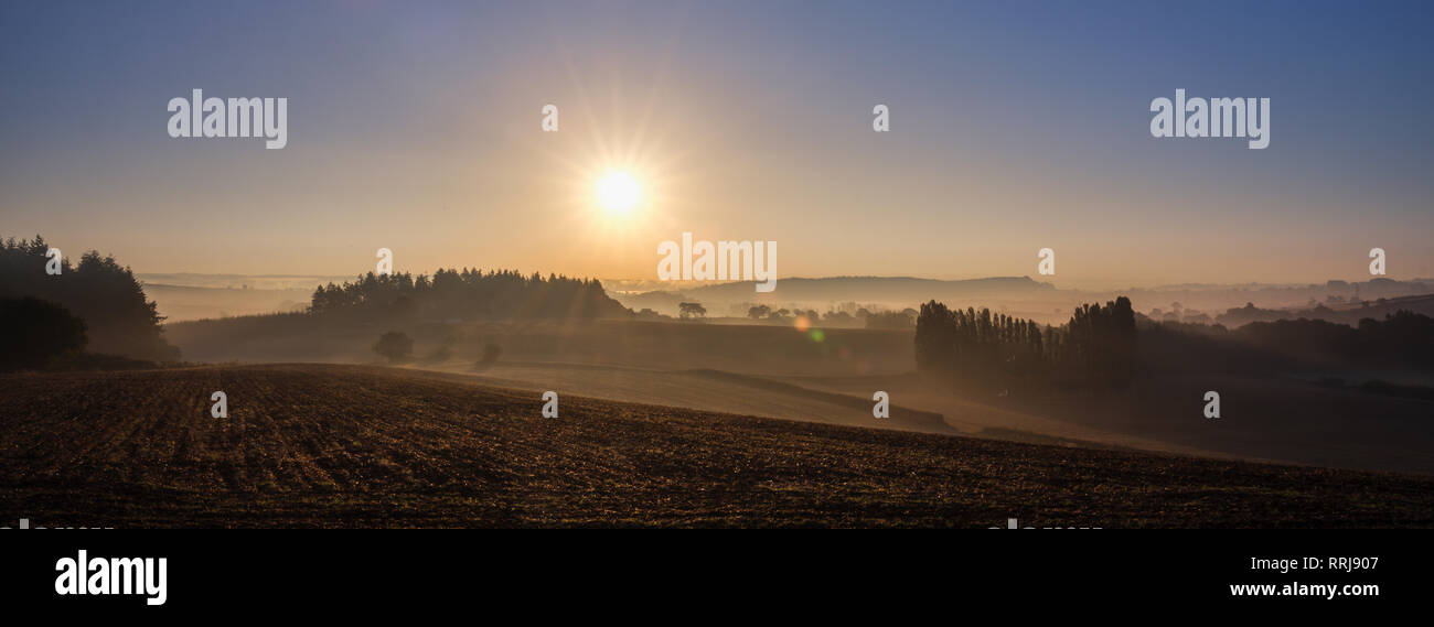 Extensive dawn mist over the fields and Exe estuary, viewed from Mamhead, Starcross, Devon, England, United Kingdom, Europe - Stock Image