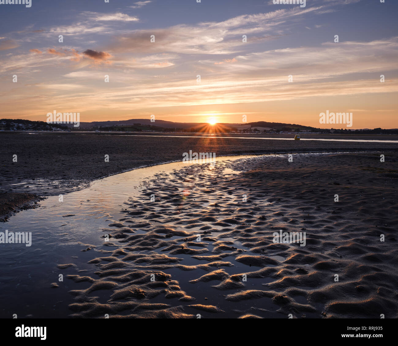 Looking at the setting sun across the Exe estuary towards Starcross from Exmouth, Devon, England, United Kingdom, Europe Stock Photo