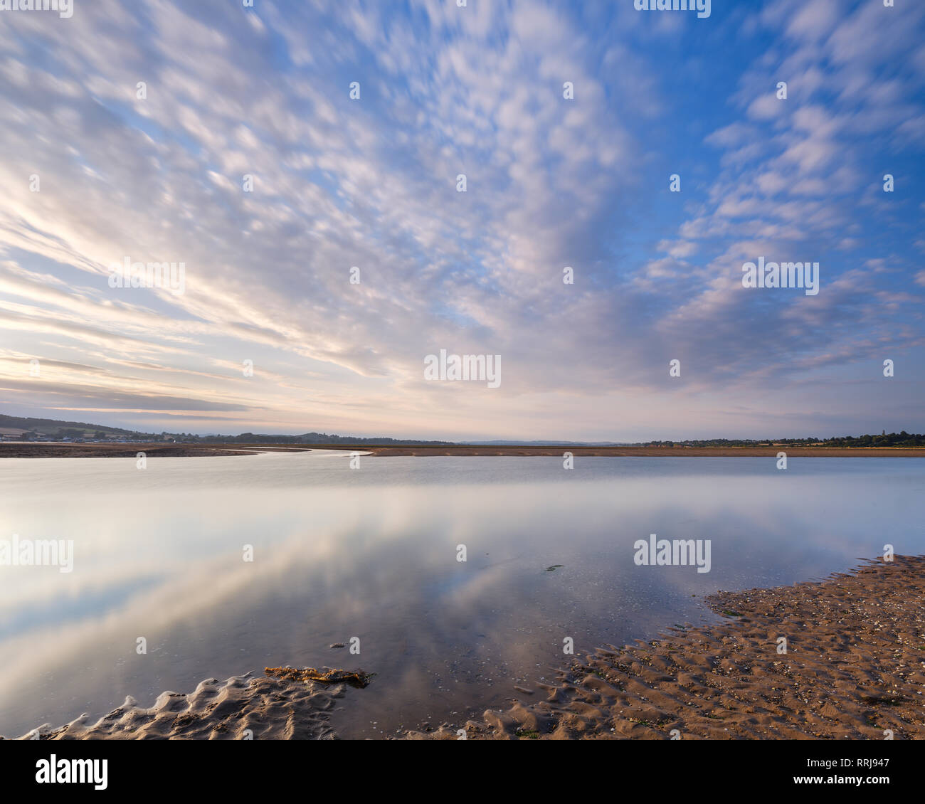 Looking North up the Exe estuary with interesting clouds and reflections from Exmouth, Devon, England, United Kingdom, Europe - Stock Image