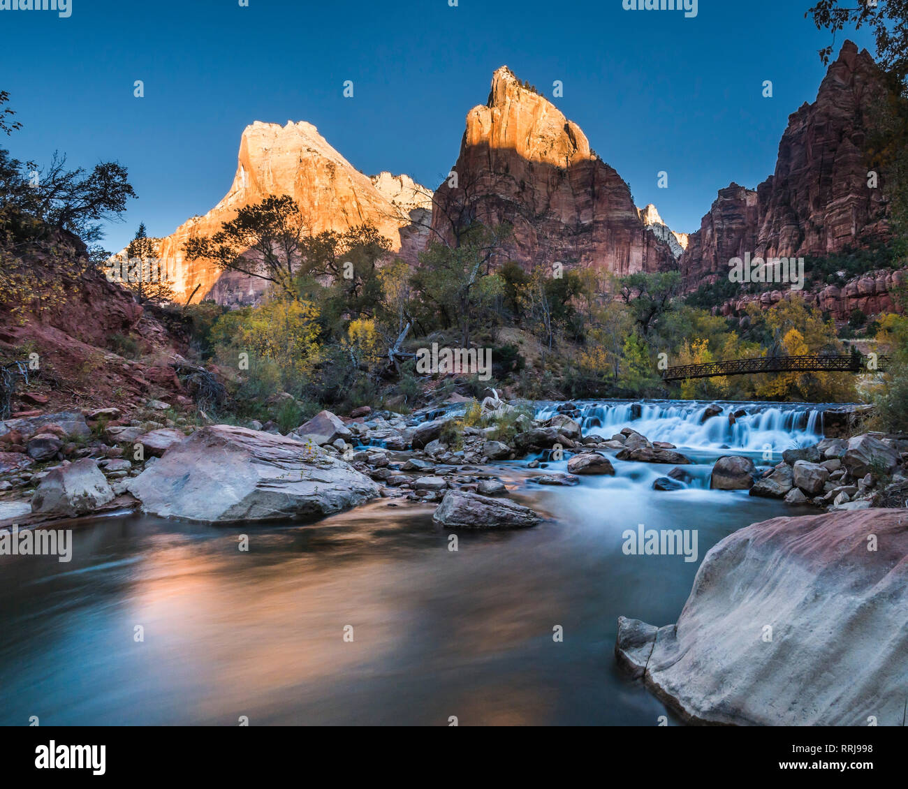 View across the Virgin River to Abraham and Isaac Peaks, sunrise, Court of the Patriarchs, Zion National Park, Utah, United States of America - Stock Image