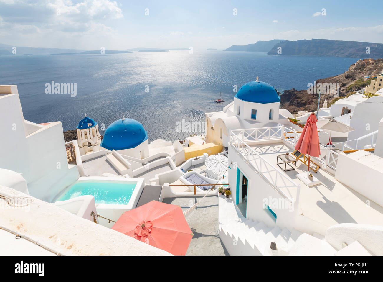 View of blue domed churches from cafe in Oia village, Santorini, Cyclades, Aegean Islands, Greek Islands, Greece, Europe Stock Photo
