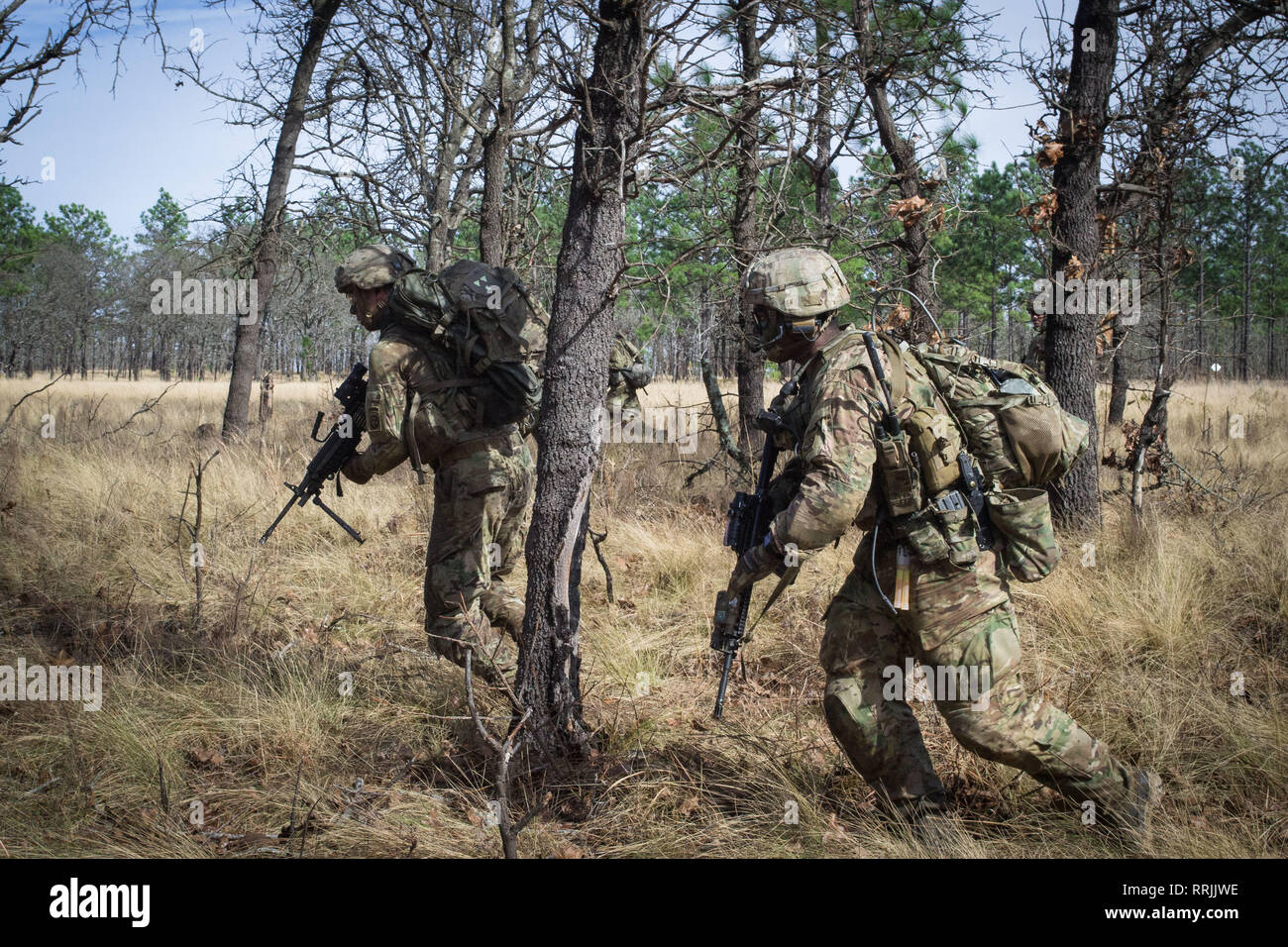 Paratroopers from Company C, 2nd Battalion, 505th Parachute Infantry Regiment, 3rd Brigade Combat Team, 82nd Airborne Division bound between cover during the Company's live-fire exercise held Sunday, February 24 on Fort Bragg, North Carolina. Stock Photo