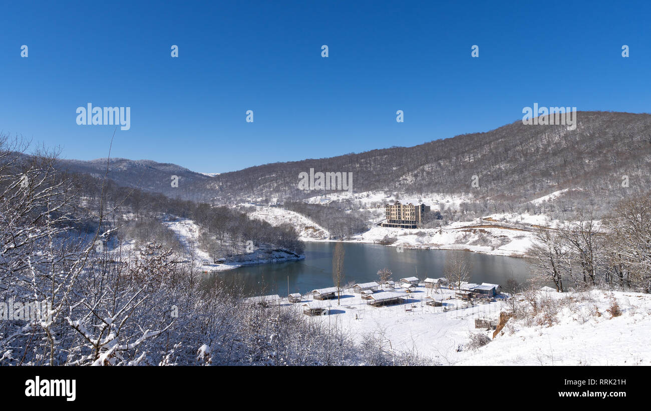 Winter landscape with a frozen mountain lake - Stock Image