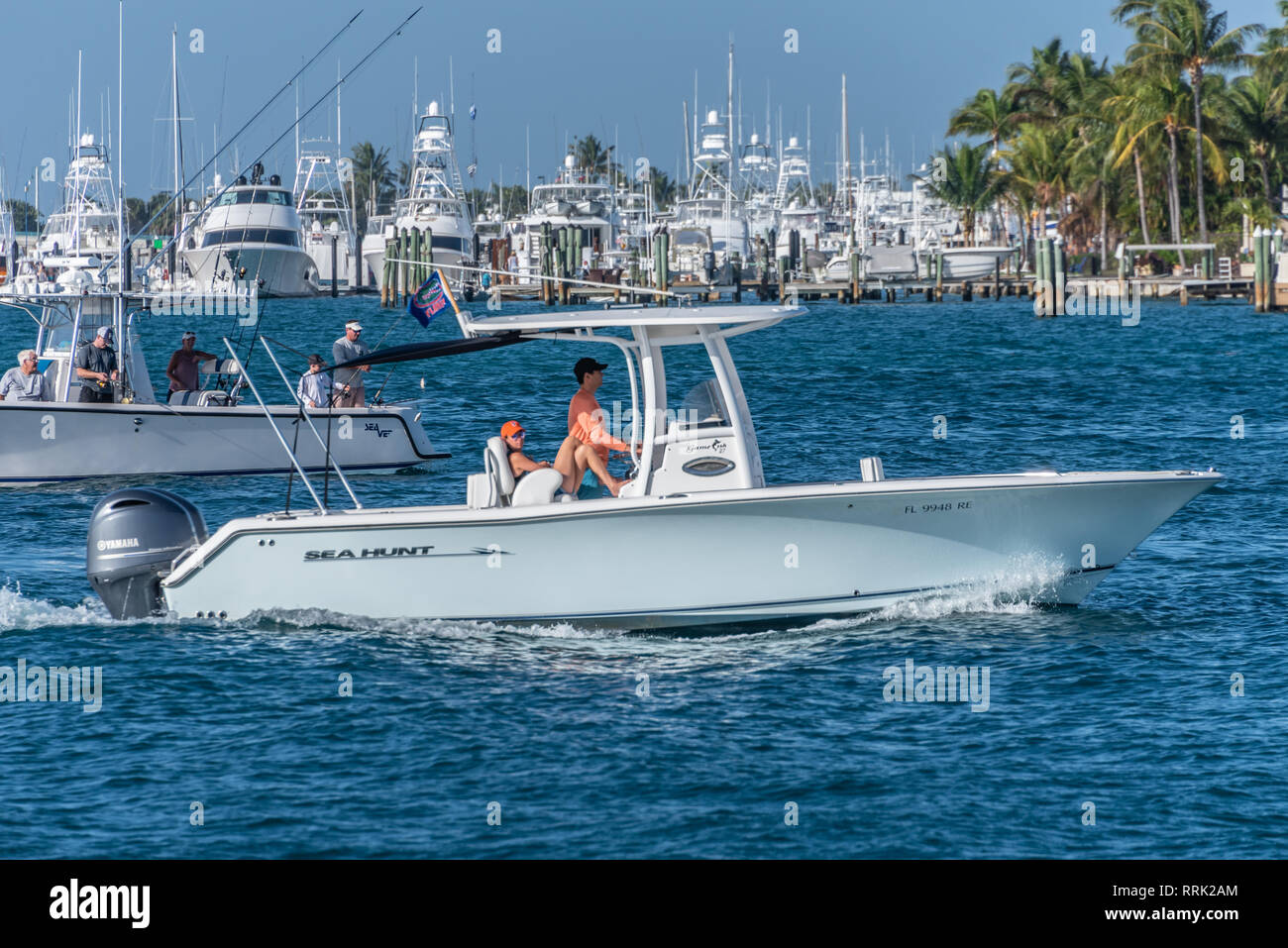 Boating in the Palm Beach Inlet (also known as the Lake Worth Inlet) off of Peanut Island in Palm Beach, Florida. (USA) - Stock Image