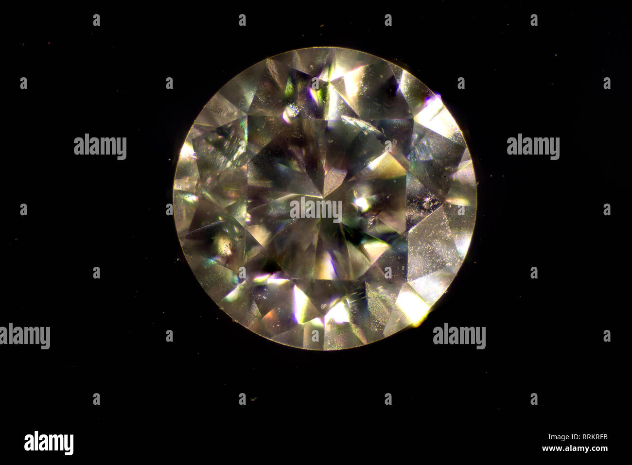MIcroscopic image. Diamond is a solid form of the element carbon with its atoms arranged in a crystal structure called diamond cubic. - Stock Image