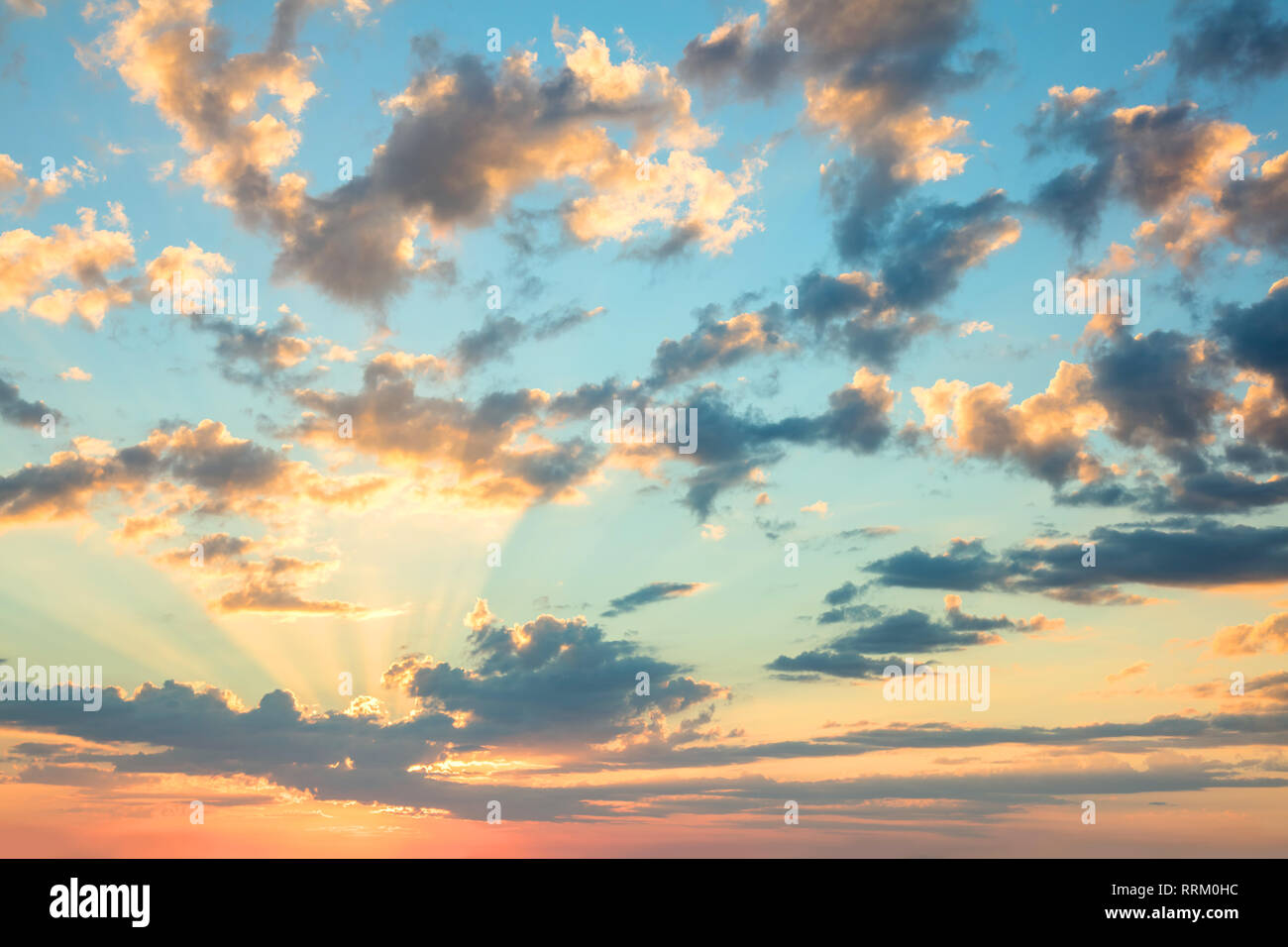 Sunshine Sunrise sky - gentle colors of soft clouds and sunshine with rays, amazing real background for wallpaper, big size - Stock Image