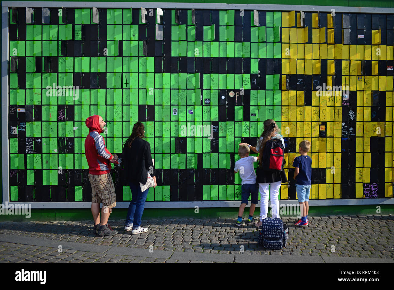Happy Wall, created by Thomas Dambo, is an analog interactive pixel sculpture made out of the remnants of Tuborg's cinema tribune at  Roskilde Festiva Stock Photo