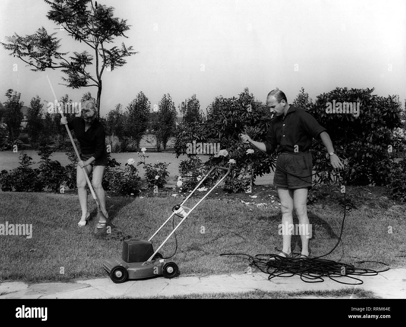 Meysel, Inge, 30.5.1910 - 10.7.2004, German actress, full length, with her husband, John Olden, gardening, circa 1964, Additional-Rights-Clearance-Info-Not-Available - Stock Image