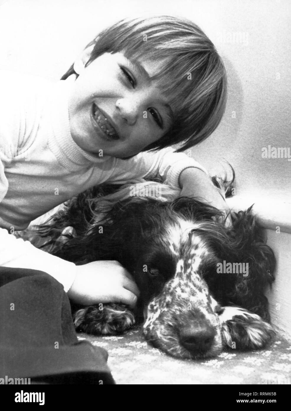 Kennedy, Matthew Maxwell, * 11.1.1965, American author / writer, as child with his dog, early 1970s, Additional-Rights-Clearance-Info-Not-Available - Stock Image