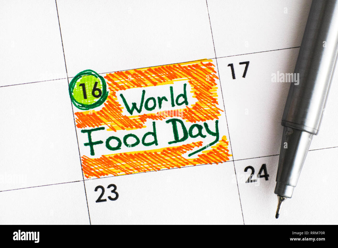 Reminder World Food Day in calendar with pen. 16 October. Close-up. - Stock Image