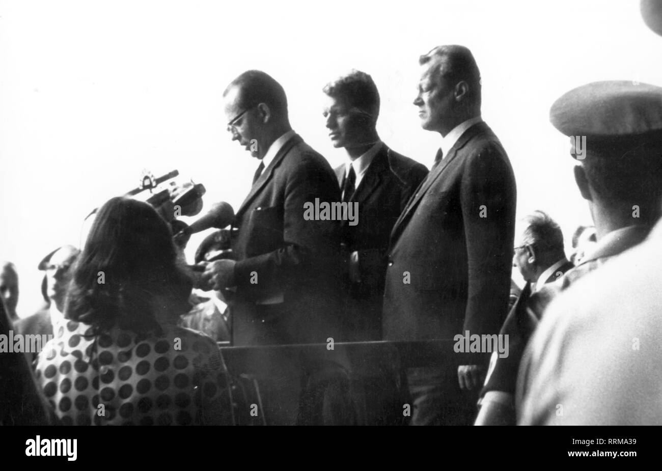 Kennedy, Robert Francis, 20.11.1925 - 6.6.1968, American politician (Democrats), American minister of justice 20.1.1961 - 3.9.1964, visit to West Berlin, with the governing mayor Willy Brandt, an interpreter translates his speech, airport Tempelhof, 22.2.1962, Additional-Rights-Clearance-Info-Not-Available - Stock Image