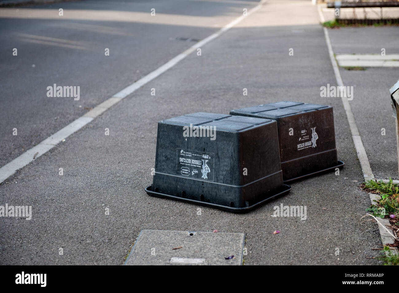 Black Box containers emptied! Local refuse collection for paper, cans and bottles. Stock Photo