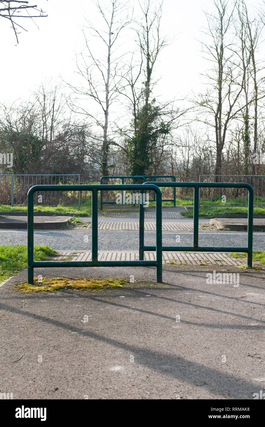Road crossing with safety barriers and dropped kerbs on Mane Way, Westbury, Wiltshire, UK. - Stock Image