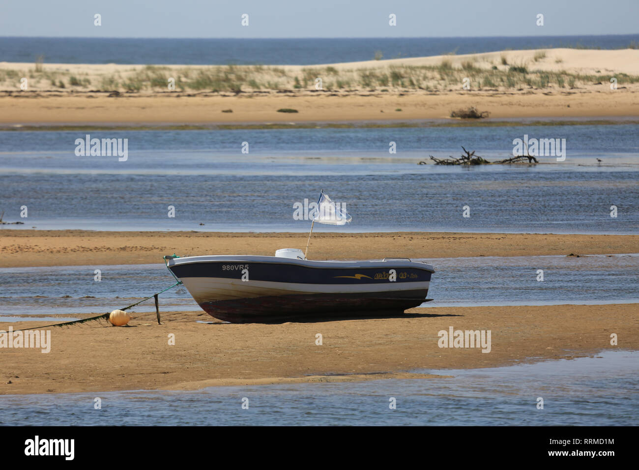 small boat lying on foreshore backwater, andalucia, spain - Stock Image