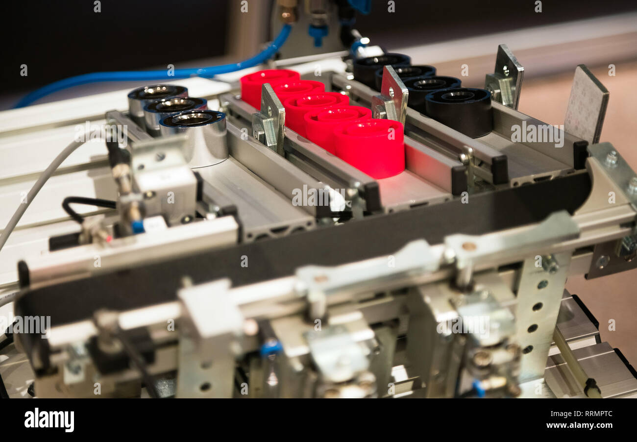 Industrial machine making plastic parts. Complex machinery manufacturing plastic things - Stock Image