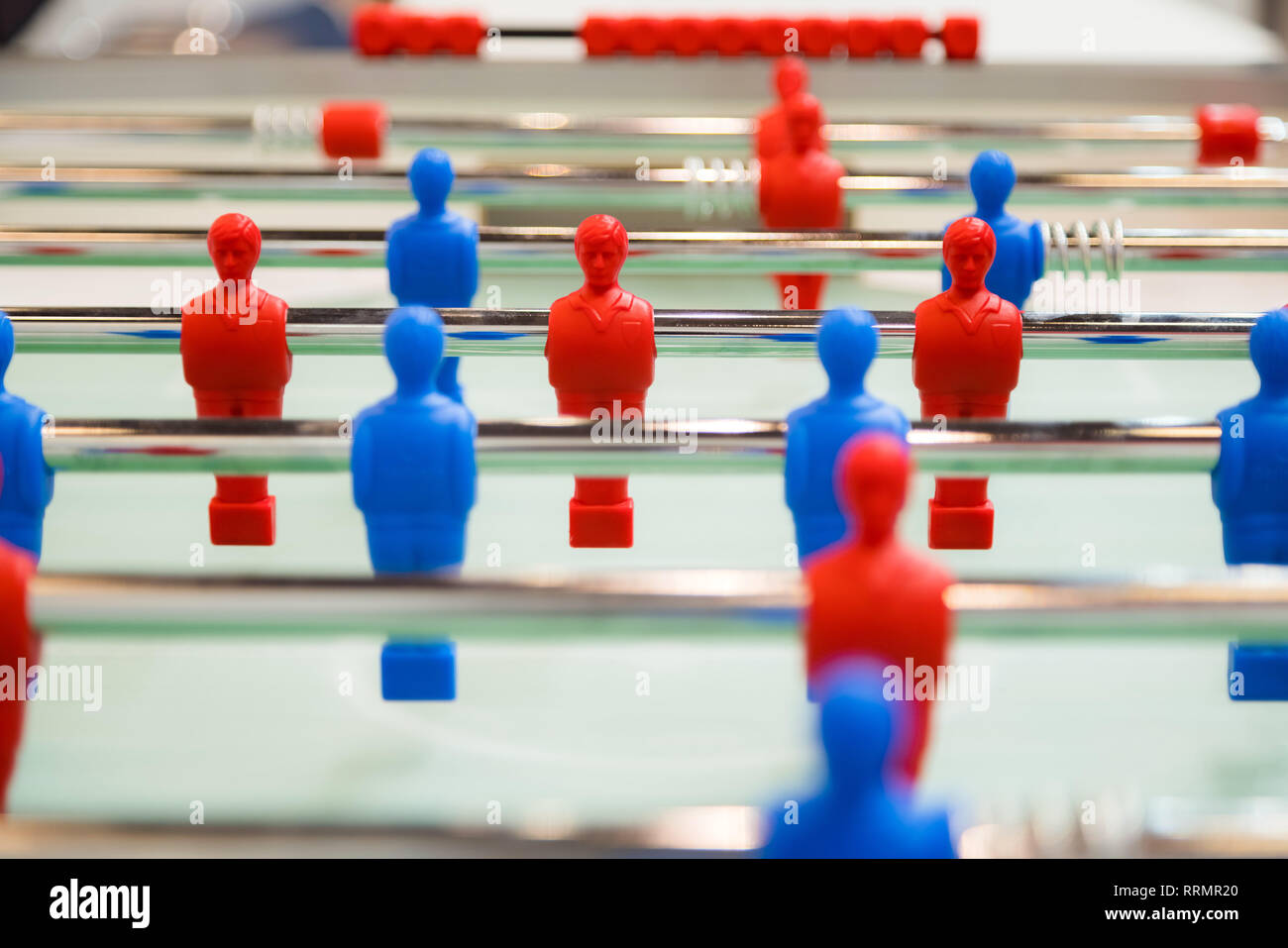 Foosball table soccer. Team sport, table football players game. Competitive table game - Stock Image