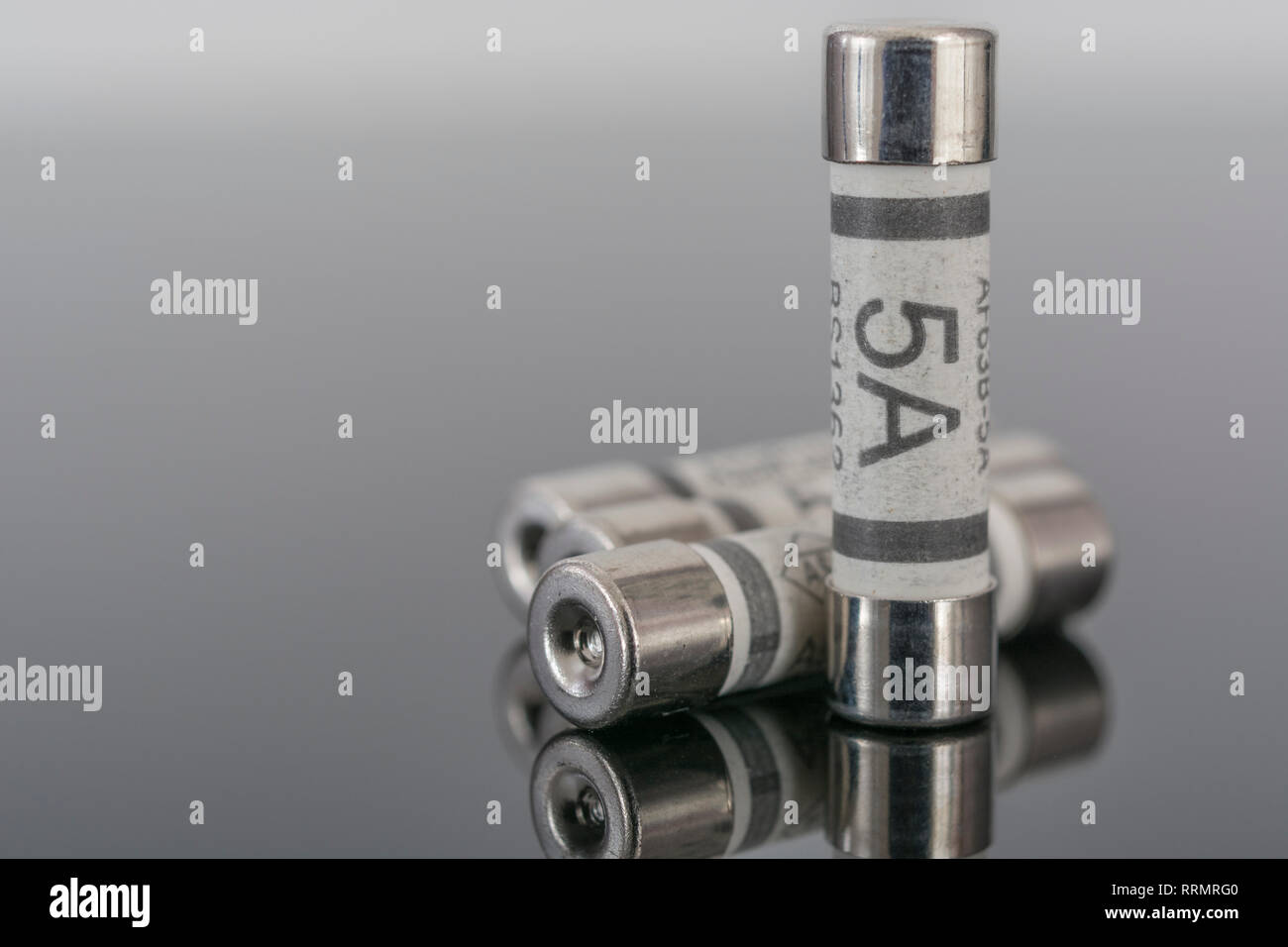 5 Amp household ceramic cartridge fuses. Stock Photo