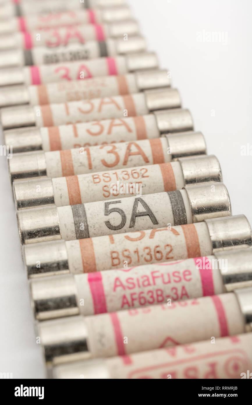 Mass of household ceramic cartridge fuses. Stock Photo