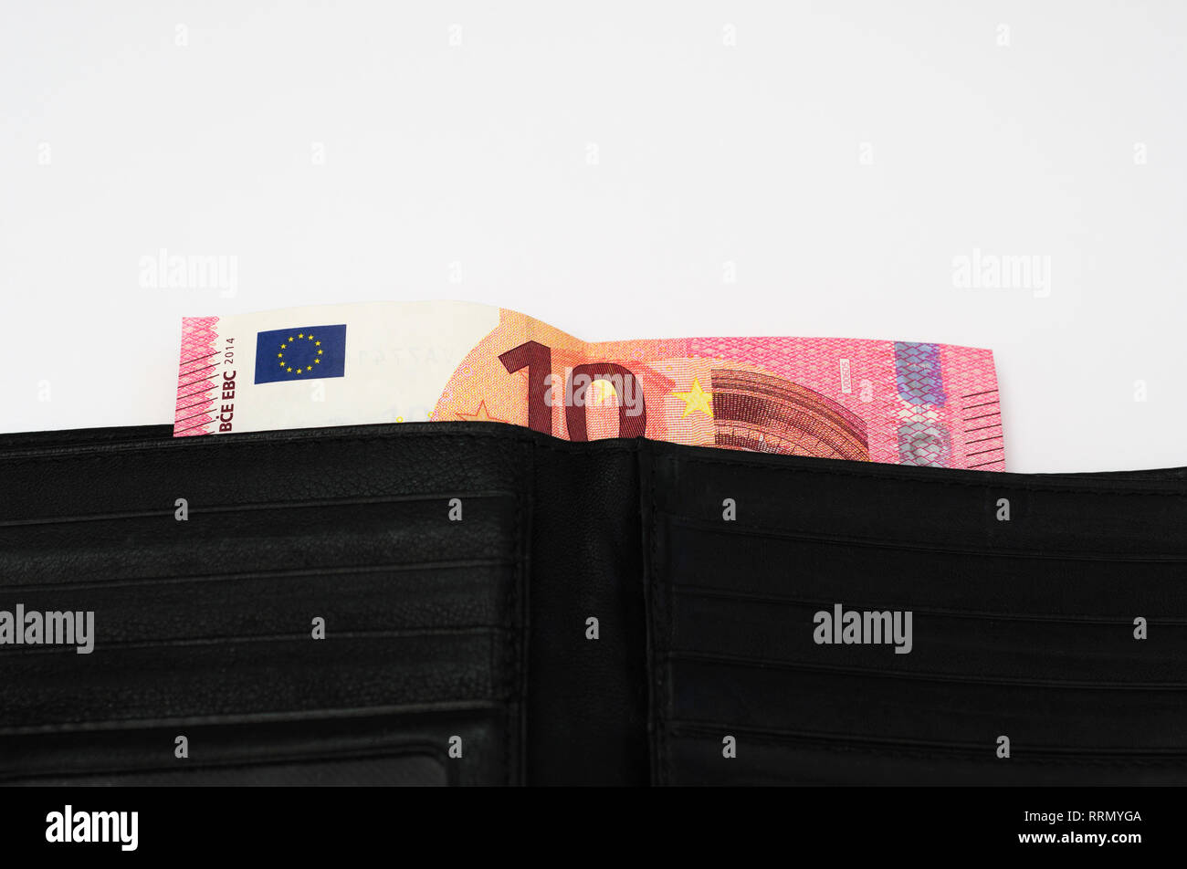 10 euro banknote sticking out of a black leather wallet - Stock Image