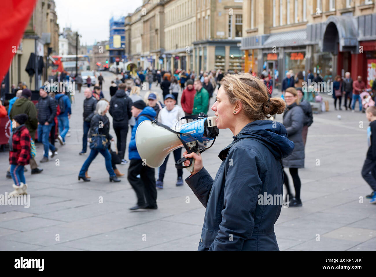 Street protestor with megaphone, Newcastle Upon Tyne, City Centre on a busy Saturday, North East England, UK - Stock Image