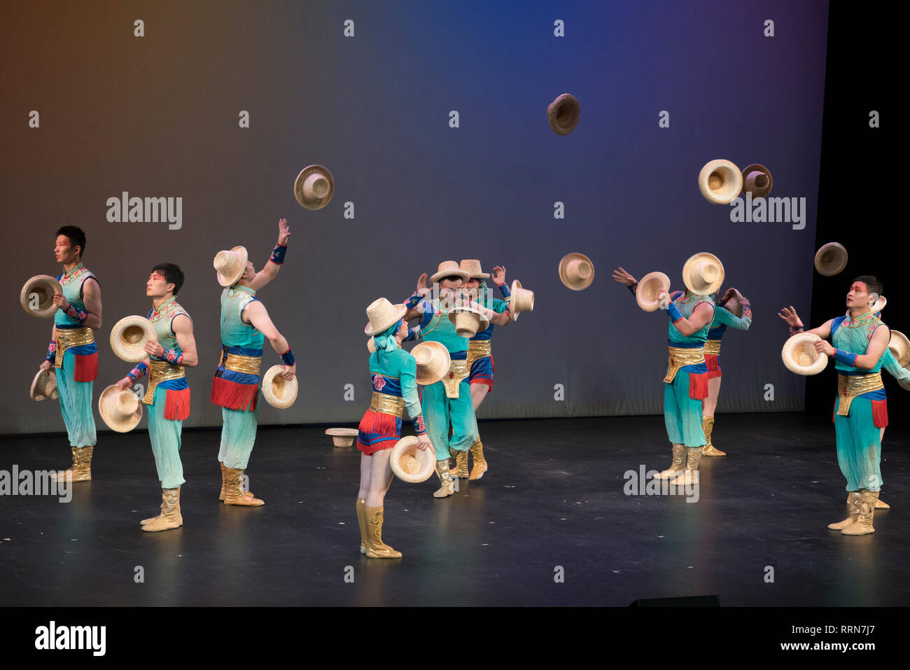 Acrobats from the New Shanghai Circus performed astonishing feats of precision, strength and balance — in this case with hats that they changed in sec - Stock Image