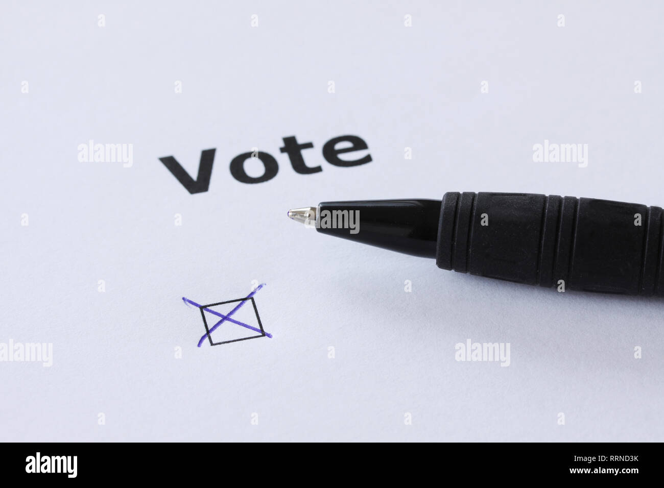 The word Vote - with mark in check box with pen lying at the side - Stock Image