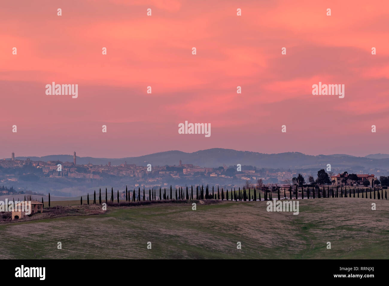 Beautiful sunset on the countryside with Siena in the background, Tuscany, Italy - Stock Image