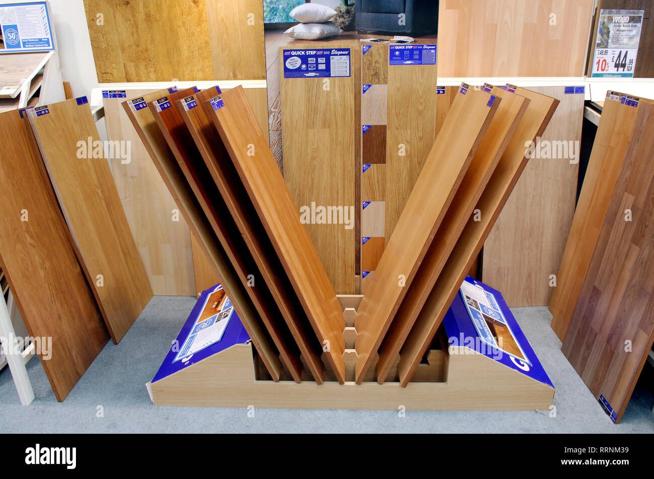 Various wood and laminate flooring for sale in a floor shop - Stock Image