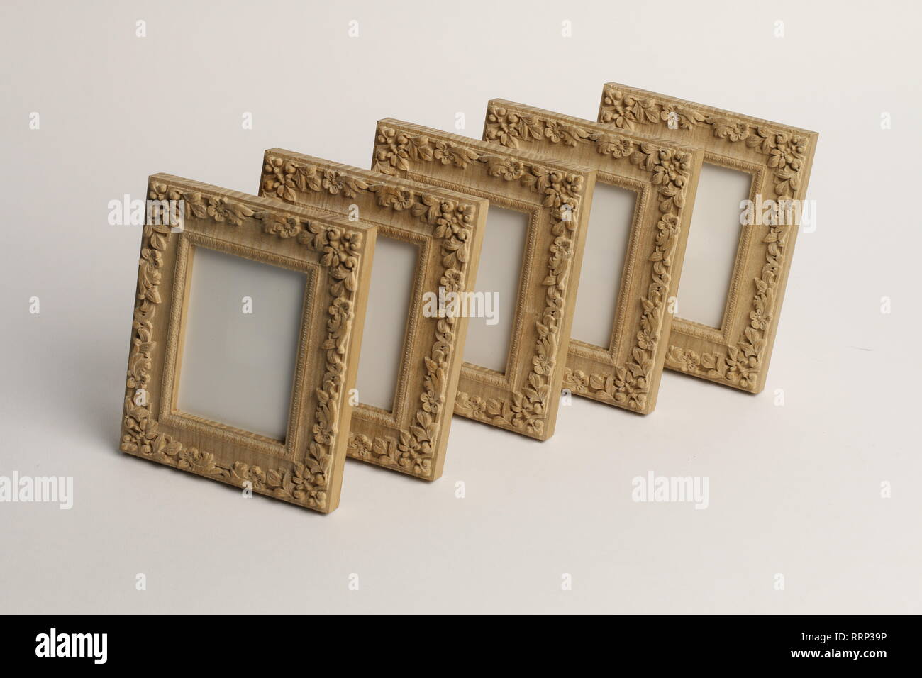 rotary miniature wooden frames cut for photographs or