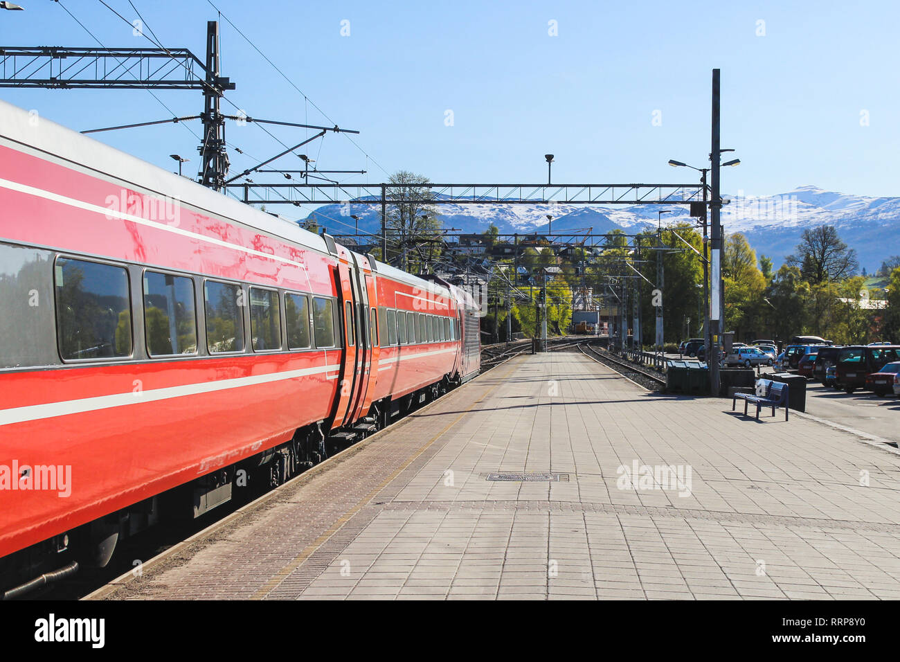 Red train has pulled into the station, Voss, Norway - Stock Image