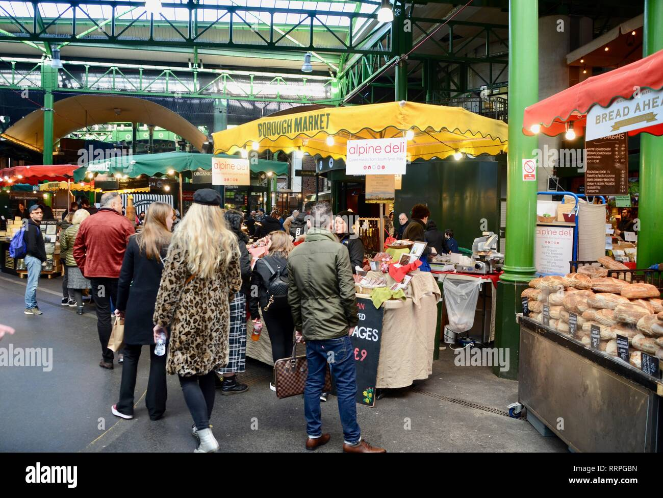 inside borough market in london with colourful stalls and shoppers - Stock Image