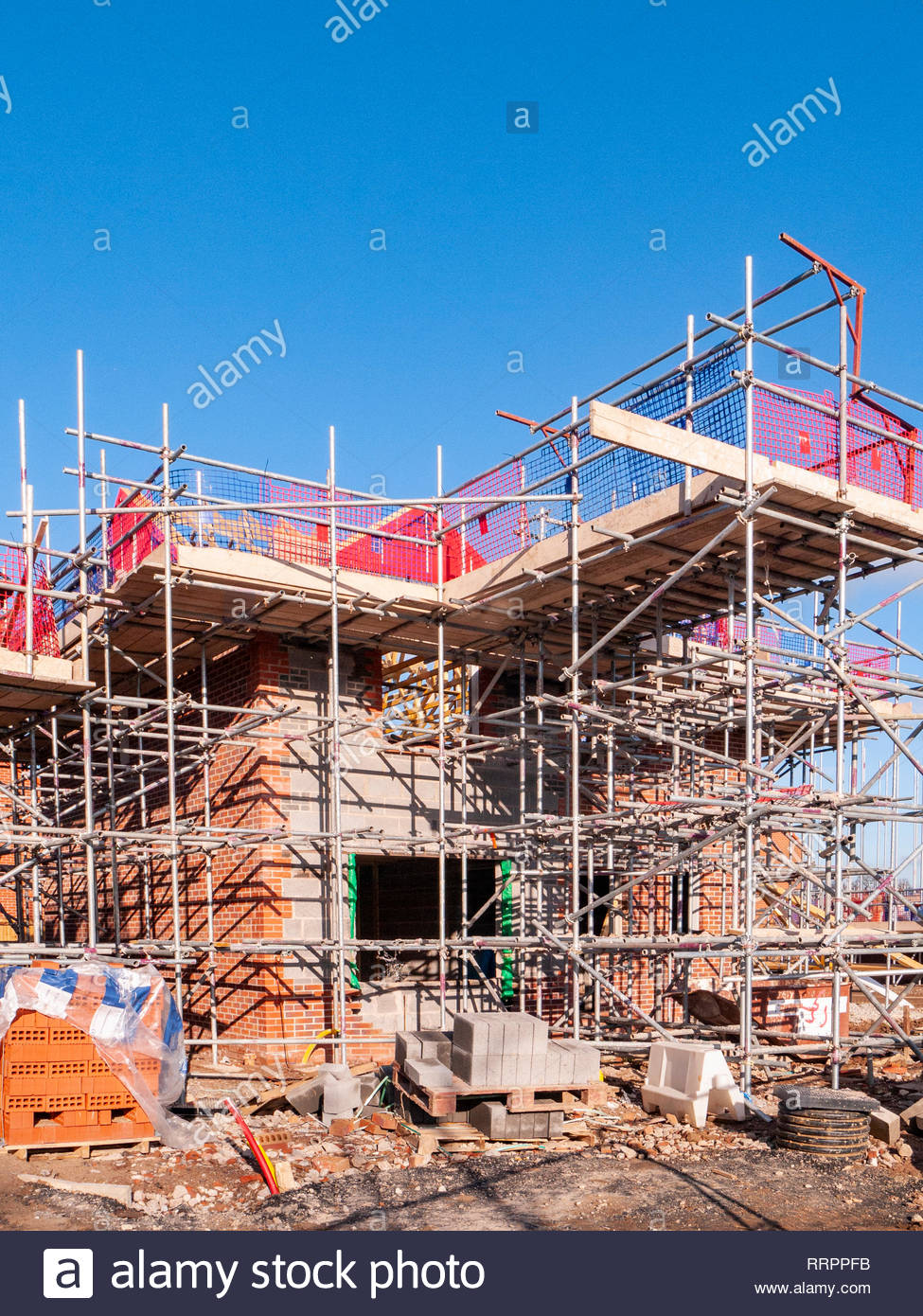 New houses in scaffolding and under construction on housing estate in Cheshire England UK - Stock Image