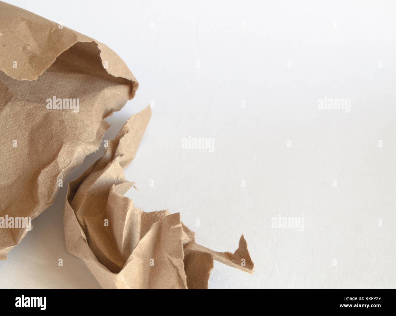 Crumpled brown wrapping paper and texture, clipping, isolated on white background. - Stock Image
