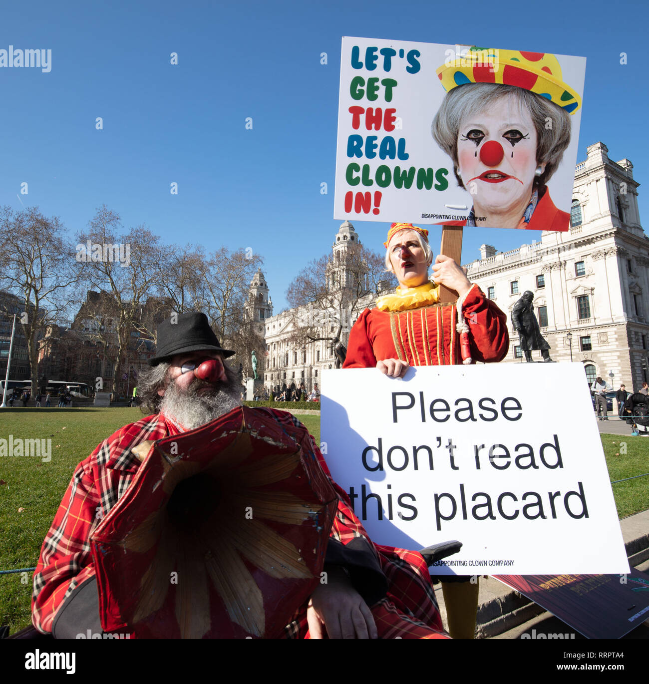 London, UK. 28th January 2019. Professor Eek (clown) and Professor Queen Bee (Judy on the right) protest outside Parliament, London, UK, today, feeling insulted that clowns and Punch and Judy are compared with those MP's inside the House of Commons. Credit: Joe Kuis /Alamy Live News - Stock Image