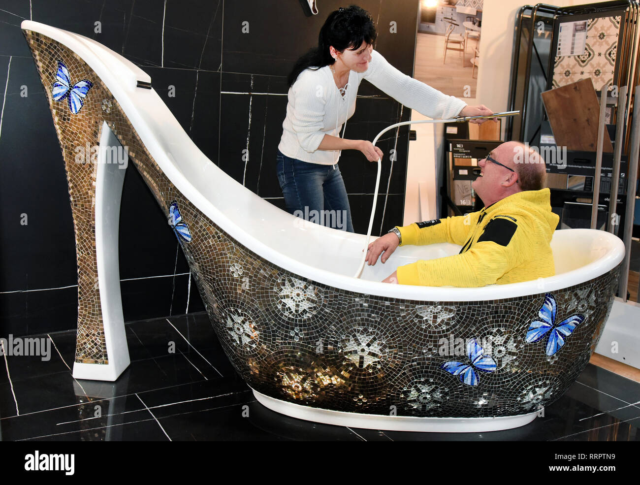 Leipzig Germany 25th Feb 2019 At The Central German Trade Fair 2019 At The Leipzig Trade Fair A Woman And A Man Will Try Out A Bathtub In Stiletto Design At A