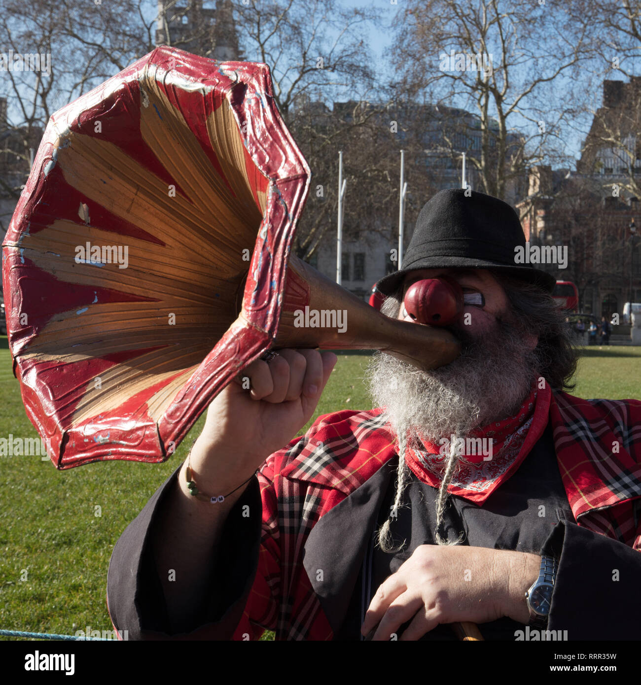 London, UK. 26th February 2019. Professor Clown Eek having an alternative Brexit protest on Parliament Square, London, UK, today, objecting be compared with politicians. Credit: Joe Kuis/ Alamy Live News - Stock Image