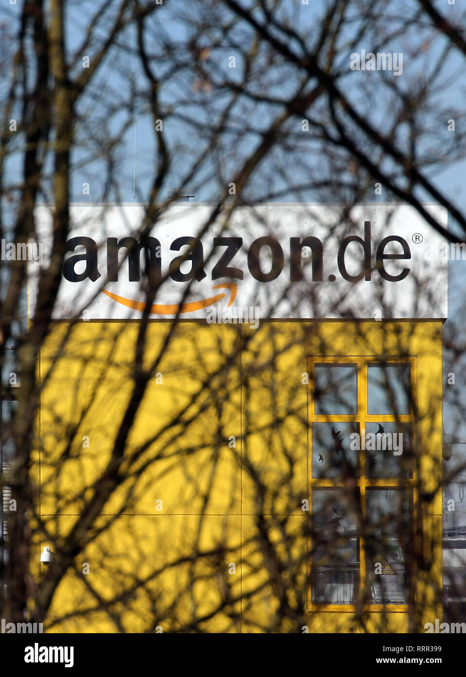45f907e3054 The logo of the Internet retailer Amazon can be seen behind bare trees at  one of the company s logistics centres. Credit  Karl-Josef  Hildenbrand dpa Alamy ...
