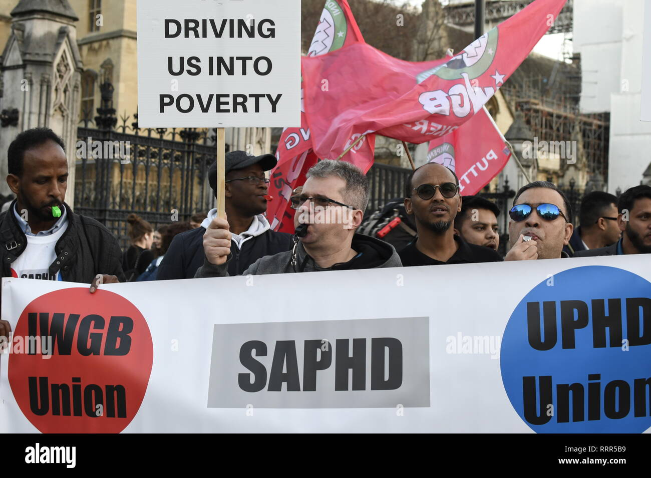 Demonstrators seen blowing whistles during the protest. Minicab drivers blocked Parliament Square in protest over changes to the congestion charge. Drivers are against congestion charges introduced by Mayor Sadiq Khan. TFL said the measure is necessary to reduce London's air pollution. - Stock Image