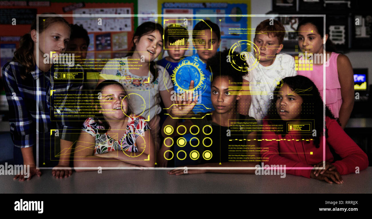 Junior high school students using futuristic touch screen in classroom - Stock Image