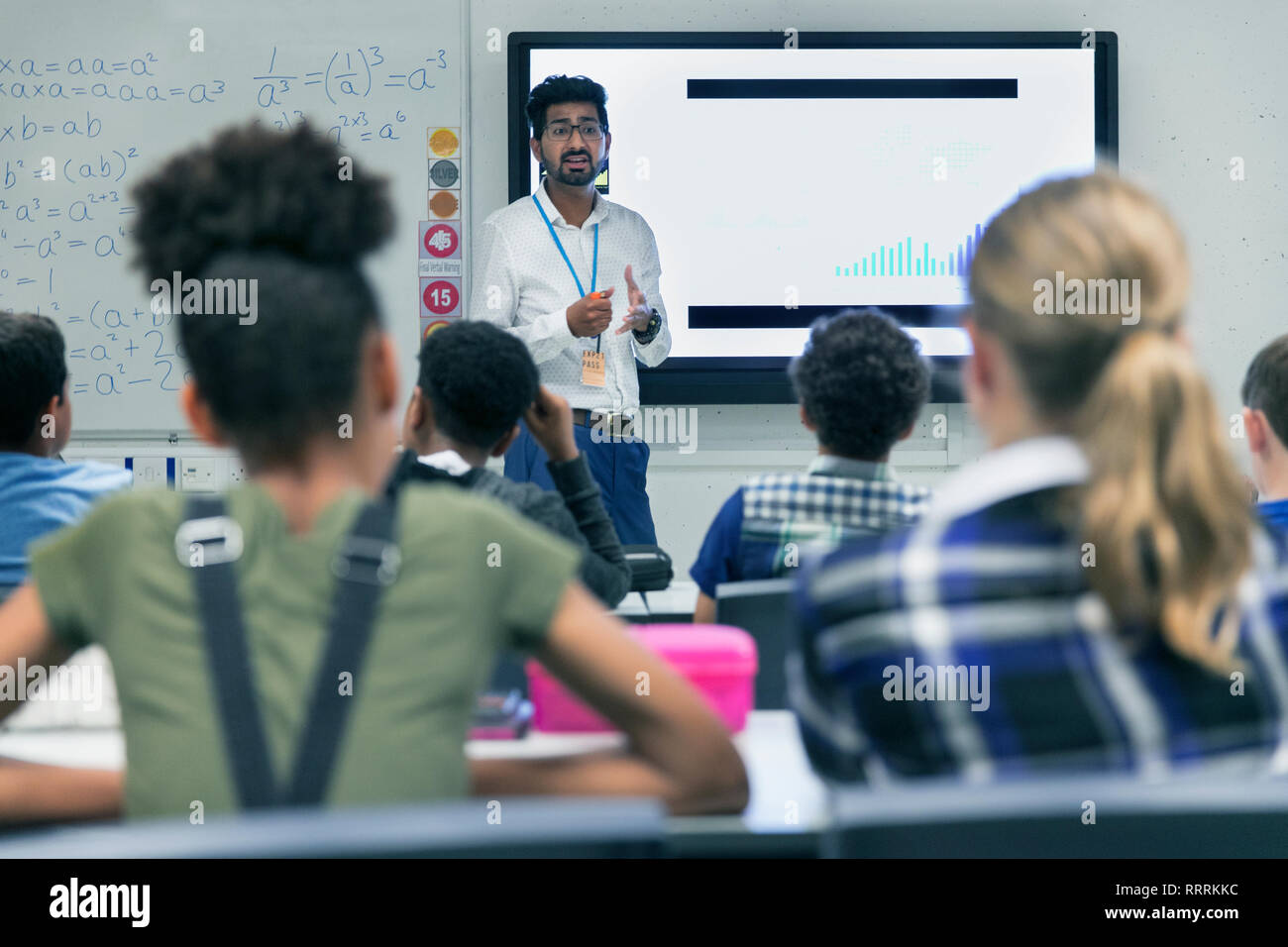 Male teacher leading lesson in classroom - Stock Image