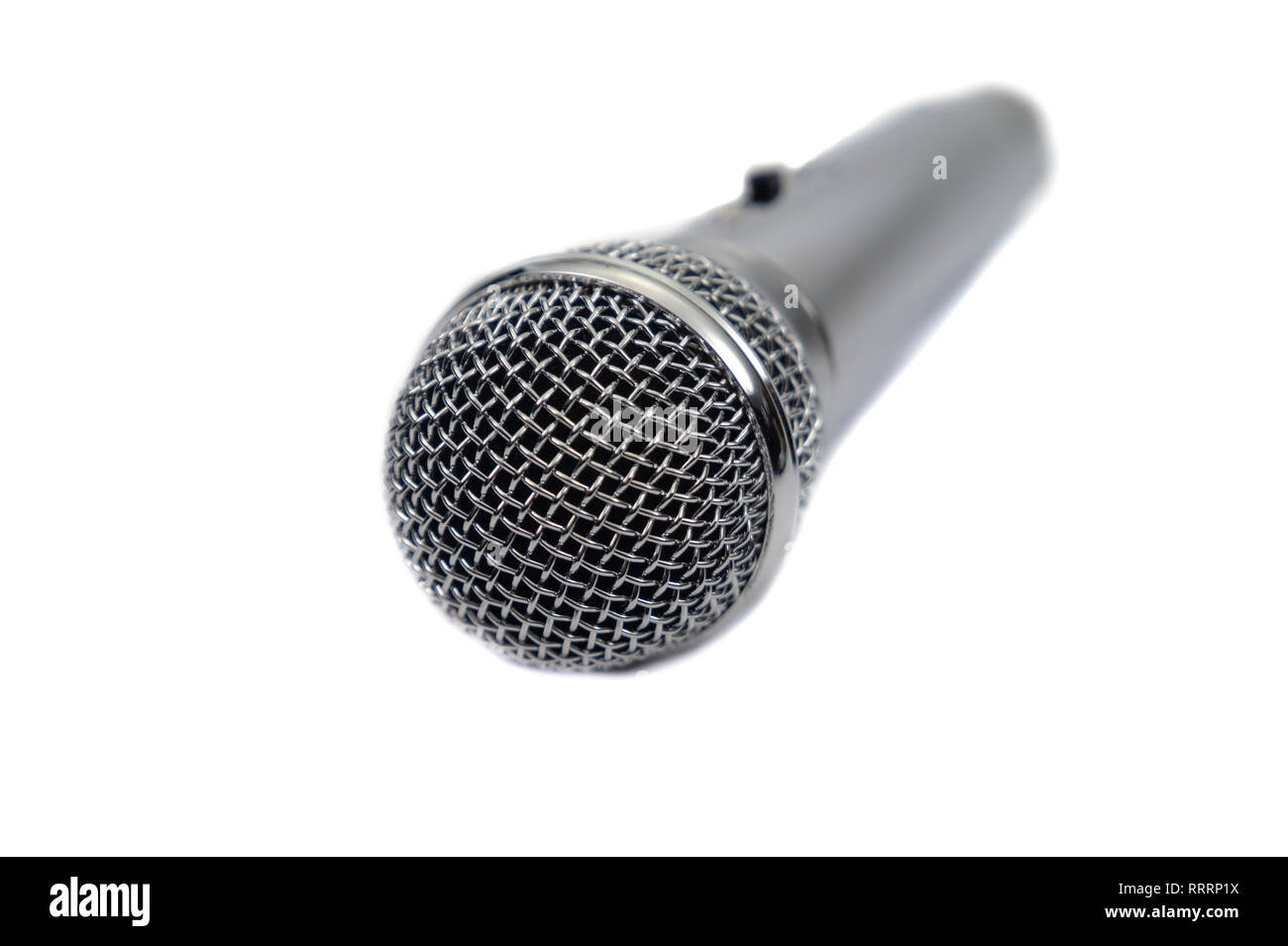 Silver vocal microphone perspective view close up isolated on a white background - Stock Image