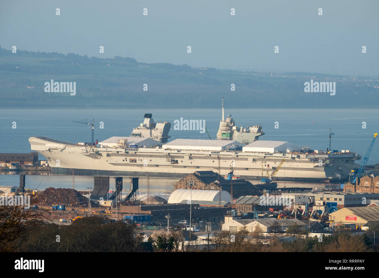 HMS Prince of Wales aircraft carrier under construction for the Royal Navy at Rosyth Naval Dockyard, Fife, Scotland. - Stock Image