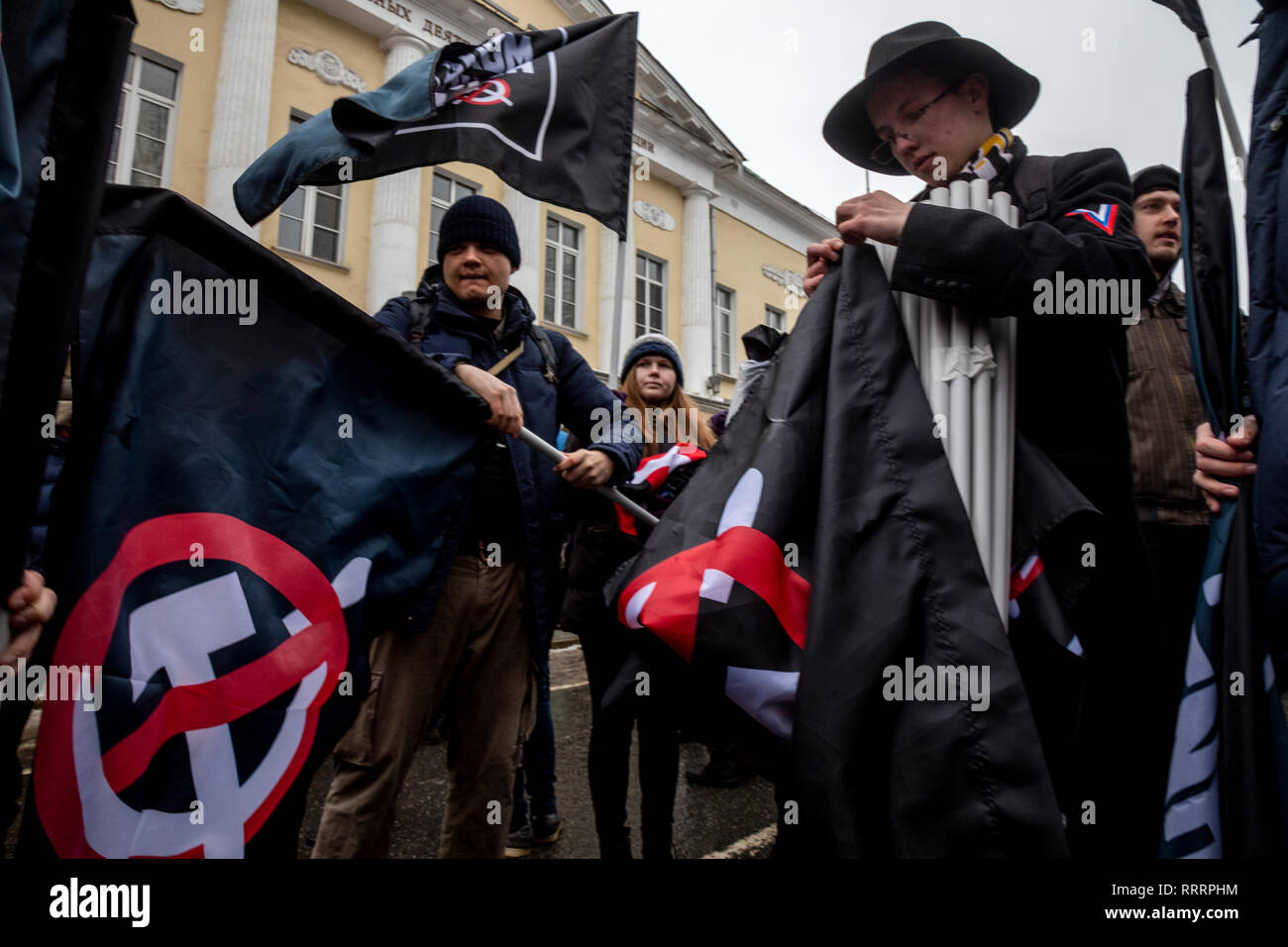 Black flags with crossed out of communist symbols of  the supporters of decommunization during opposition March in memory of politician Boris Nemtsov - Stock Image